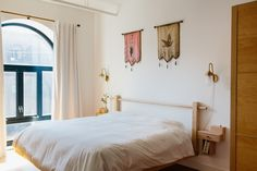 Our Pelle Gooseneck sconce seen in Calico Wallpaper's gorgeous Brooklyn Red hook loft. From Sight Unseen !