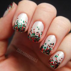 Christmas Nail Art - elevate a white mani by sprinkling festive red and green glitter on the bottom of your nails. (This is also a great way to hide any chips or imperfections before a last-minute soiree.)
