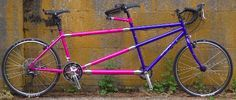 Love the paint job on this Rodriquez tandem bike. The frame has couplers so you can take it apart for transport. The best part? I get to ride the pink part of the bike and my hubby rides the purple part! ;-)