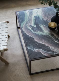 Siena coffee table finished in Bronze with Rosso Luana #marble top.