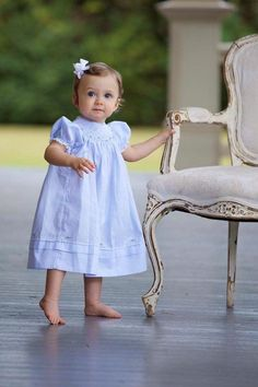 In case you were wondering, this is why your baby *needs* some blue in her closet! Tilly is absolutely beautiful in her Bishop dress with Rosettes!  This beautiful dress comes in blue or pink in sizes 3m-4t!  Beautiful image by Kathlyn Dragna Photography https://feltmanbrothers.com/bishop-dress-with-rosettes/
