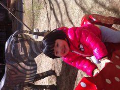 Riding a horse!
