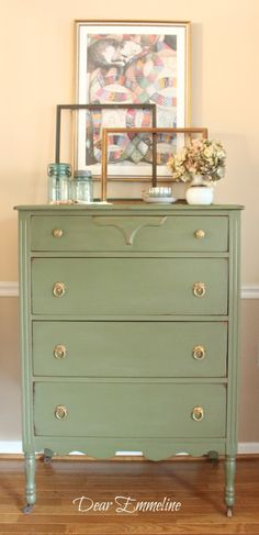 Paint your dresser a light olive green and switch out the handles for antique door-knockers, a simple update for an old piece.