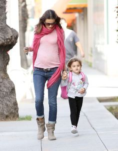 Alessandra Ambrosio looked extra girly in a pale pink top and a contrasting fuchsia scarf.