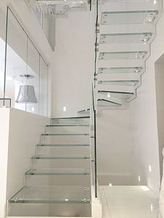 Light, elegant and design : Lounge stairs with extra clear glass and white lacquered steelLOUNGE STAIRS. stairs : straight, quarter or half turn, free standing. frame : one or two lateral beams in L shape, in stainless steel or lacquered...
