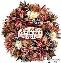 God Bless America Patriotic Wreath, Burlap Front Door Wreath, July 4th Wreath, American Wreath, Memorial Day Wreath, Memorial Day Decor  This festive red, white, and blue God Bless America Patriotic Wreath, can be used to decorate your door or wall. The wreath is made of a natural Natural Poly Jute Mesh with Metallic Red Stripes and trimmed with multi-ribbon bows, matching ribbons, metal stars, cream hydrangea, and Metal God Bless American Land That I Love.  Product Description: Handmade…
