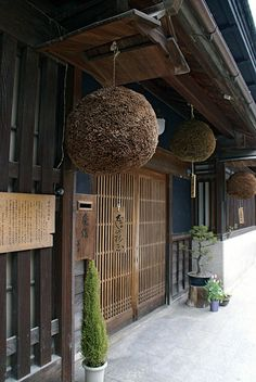 """Sugitama or Sakabayashi "" is  a ball sculpture collected to form a ball of cedar leaves. It is hung on the eaves of the sake brewery, indicating that there is new sake. Its termed ""begin to squeeze."""
