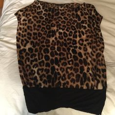 Express leopard top Used Leopard polyester top with rayon band. In good shape. Express Tops