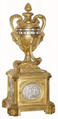 1870, French, Annular Dial Clock, a 4 sided ormolu base rising to an urn,