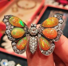 In another world, this fire opal and diamond butterfly brooch would have the awesome power to summon a gust of balmy weather with a beat of its wings that would sweep in and miraculously thaw the city. Until then, I'm staying under the duvet.