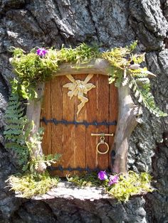 fairy door.  I need one of these on my trees