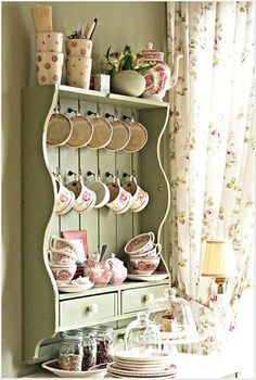 Love the look of hanging tea cups/mugs. Not only for looks but to use.