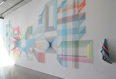 adrian esparza weaves and nails serape threads to the wall, wake and wonder, 2013 serape and nails