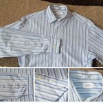 """J Crew Mens S(14-1401/2) Blue Stripe Long Sleeve Shirt  1 Pocket  Button Front  100 % Cotton   Has 2 small lite spots 5th button down other wise In excellent Pre-owned condition with no stains or holes.   Aprox. Measurements Taken Flat  Shoulders: 19""""  Chest: 20""""  Sleeves: 26420""""  Length: 31.5""""    $16.99 Free Shipping         Item"""