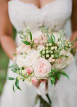 lovely bouquet of pale pink garden roses, pale pink hypericum berry, pale pink ranunculus, and godetia