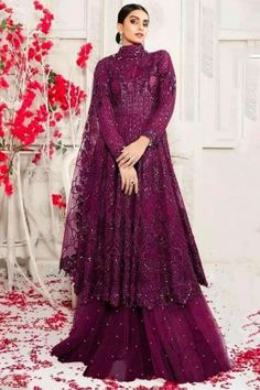 To complement your graceful demeanour, Andaaz fashion presents this wine maroon net sharara suit which comprises an elegant ethnic look. This closed neck and full sleeve party wear sharara suit beautified with stone, sequins and thread work. Set together with net sharara pants in wine maroon color with wine maroon net dupatta. Sharara pant has stone work. #shararasuits #malaysia #Indianwear #weddingwear #andaazfashion Indian Attire, Indian Wear, Indian Outfits, Pantalon Cigarette, Sharara Suit, Wear Store, Ethnic Looks, Maroon Color, Wedding Wear