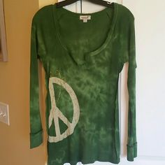 NWOT One world long sleeve top New never worn One World long sleeve top with peace sign. Was a gift to me but I never wore it. Has a slight tye dye look. Tops Tees - Long Sleeve