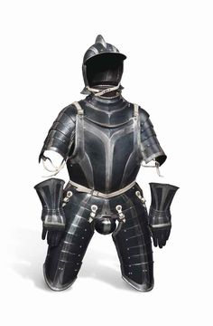 Lot 67 - A COMPOSITE GERMAN BLACK & WHITE INFANTRY THREE-QUARTER ARMOUR LATE 16TH CENTURY Comprising one-