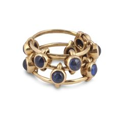 JAR. A YELLOW GOLD AND SAPPHIRE RING. Designed as three gold hoops connected by sliding sections each set with a cabochon sapphire, 1980s, s...