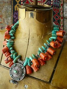 Stunning necklace by Helena Nelson-Reed. A contemporary Tibetan gau pendant is combined with Sleeping Beauty Mine (US) turquoise, bamboo coral dangles and sterling silver spacers. On either side of the clasp are conch shell beads from Nepal. Tribal Jewelry, Turquoise Jewelry, Boho Jewelry, Jewelry Art, Beaded Jewelry, Handmade Jewelry, Beaded Necklace, Jewelry Design, Fashion Jewelry