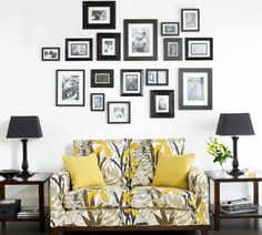 Risultato della ricerca immagini di Google per http://www.luminns.com/wp-content/uploads/2013/09/two-seater-sofa-with-yellow-pillows-and-black-table-lamps-with-side-tables-and-photo-on-white-wall-adorn-minimalist-home-interior-with-wood-floor-915x823.jpg