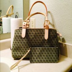 "Dooney&Bourke signature medium shoulder bag. Dooney & Bourke Green Signature Handbag & wristlet, Jacquard & Leather Satchel or shoulder bag. Discoloration on the handles and the bottoms. inside have cosmetic blemish and pen marks. Zipper works well. Handel  Material: Jacquard and Leather. The center has a zipper closure with the Gold Dooney & Bourke medallion Logo. Original Logo located on end of the Zipper. Approximately 9.3""Hx14""Lx14""W. Dooney & Bourke Bags Shoulder Bags"