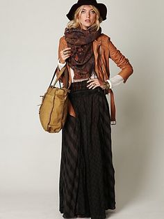 layer leather jacket over white top with chuncky scarf and maxi skirt
