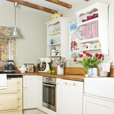 Pretty white country kitchen with red,pink and blue accents