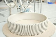 """""""Previously one could only make small 3D printed ceramics such as small cups. I was interested in full scale imposing ceramic objects, resolved objects that could serve as a centerpiece of a room. I explored randomness, textures and layers. Through much experimentation and iteration I was able to complete this project."""""""