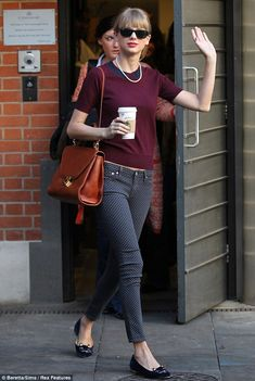 Autumnal chic: Taylor Swift steps out in skintight polka dot jeans and a maroon top with cute collar detailing in London