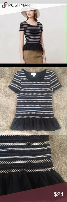 """Anthropologie Meadow Rue Smocked Peplum Tee Cute black woven top with white and tan stitching and a peplum accent. Great pre-loved condition. Marked M but runs small. Flat measurements: 13"""" at armpits, 22"""" long from top of shoulder. Lots of stretch. Anthropologie Tops"""