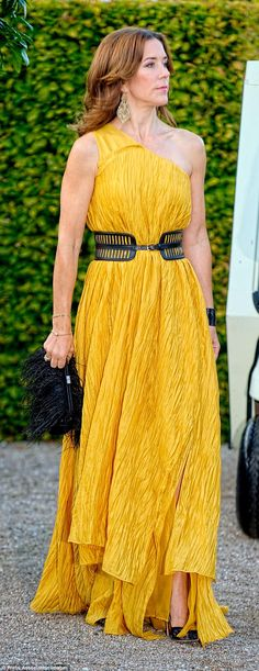 She's the Boss:A dark feather-covered clutch was the perfect counterpoint for Mary's gold...