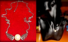 Silver tone necklace with wing charms and imitation pearl bead