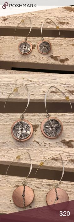 Super chic hanging silver&copper earrings Super chic hanging silver&copper earrings. Worn only a handful of times. Tribal like look to these dangling earrings. About 2.5in long. Chain embellishments. Jewelry Earrings