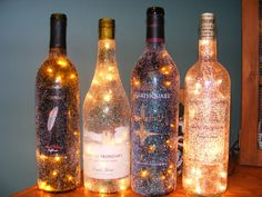 I collect used alcohol bottles for my future bar that I WILL have in my house (lol) this is a great idea for some of them! Glitter Wine Bottles, Old Wine Bottles, Wine Bottle Crafts, Glass Bottles, Alcohol Bottles, Lighted Wine Bottles, Bottle Lights, Cute Crafts, Diy Crafts