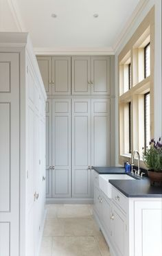 Floor To Ceiling Laundry Room Cabinets - Design photos, ideas and inspiration. Amazing gallery of interior design and decorating ideas of Floor To Ceiling Laundry Room Cabinets in laundry/mudrooms by elite interior designers. Grey Laundry Rooms, Laundry Room Cabinets, Laundry Room Design, Kitchen Design, Kitchen Cabinetry, Kitchen Sinks, Kitchen Floor, Room Kitchen, Cupboards