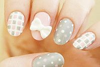 Not sure about the bow, but the pink, gray and white patterns are cute nail polish designs!
