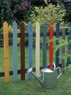 Playful Posts  Fencing adds an element of whimsy when pickets are painted different colors.