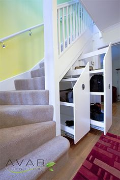 Dignified White Wooden Banister Rail With Grey Carpet Runner And Cool Cabinetry Puul Out Storage Under Stairs For Organizing Designs Staircase Storage, Stair Storage, Gun Storage, Modern Staircase, Staircase Design, Foyers, Stairs Bulkhead, Under Stairs Storage Solutions, Stair Landing Decor