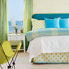 Lemonade-colored walls create a sunny backdrop for green and blue fabrics.