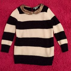 Black and white striped sweater This hardly worn black and white striped sweater has a sequin, Peter Pan collar. I believe I purchased this at Anthro, but the brand is Pim & Larkin. Anthropologie Sweaters Crew & Scoop Necks