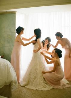 Peach bridesmaids and the bride