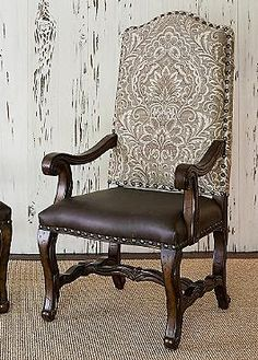 Create a truly elegant dining experience with the Florence Arm Chair that features an intricately carved hardwood base finished in brilliant mahogany and topped with a gorgeous damask patterned fabric and plush cushion.