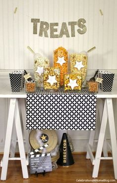Decorations can make or break any themed party. Deck out your space in gold and glitter to ensure a sparkling evening. With lots of balloons, confetti, streamers, and a center for sweets, you'll be sure to have a sparkling evening. Check out this popcorn bar that fits perfectly for your movie theme and is all sorts of fabulous with decorations! via Celebrations At Home