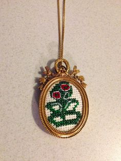 Tiki embroidery framed necklace