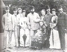 Danish Royal Family, Summer 1880 -  From left: Valdemar, Freddy, Lovisa, Minny, Alexander, Queen Louise sitting with her dog, Olga, Villy, Alix and Christian IX