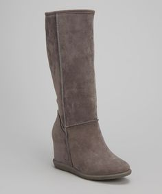 Sport some fashion without sacrificing function! These simple yet stylish boots feature a hidden wedge for added height and a flat sole to keep even the busiest of moms firmly grounded.4'' heel15'' shaft15.5'' circumferencePull-onMan-made