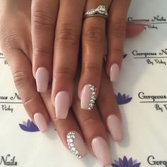 Light pink coffin nails with stone art