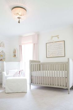 lay baby lay classic, polished pink nursery reveal. featuring our marcelle crib, wingback glider & ottoman, scallop rug, dauphine crystal flushmount, petite house shelving, cotton canvas drapery, hush little baby sheet music and wool felt bunny mobile.