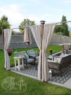 s 13 ways to get backyard privacy without a fence, fences, outdoor living, Make a private nook using curtains and rods